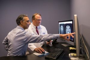Radiology experts going over a scan
